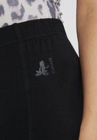 Curare Yogawear - PANTS FLARED LEGS - Tracksuit bottoms - black - 4