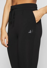 Curare Yogawear - LONG PANTS - Tracksuit bottoms - black - 4