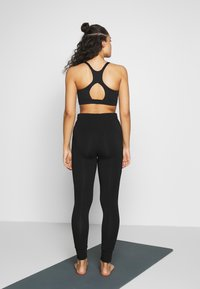 Curare Yogawear - LONG PANTS - Tracksuit bottoms - black - 2