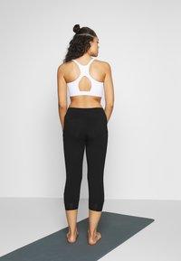 Curare Yogawear - PANTS - 3/4 Sporthose - black - 2