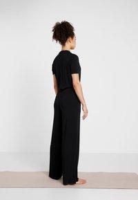 Curare Yogawear - JUMPSUIT - Chándal - black - 2