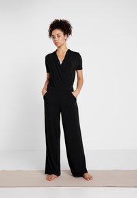 Curare Yogawear - JUMPSUIT - Survêtement - black - 1