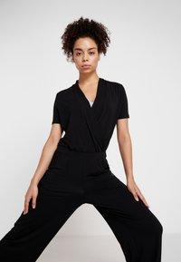 Curare Yogawear - JUMPSUIT - Chándal - black - 3