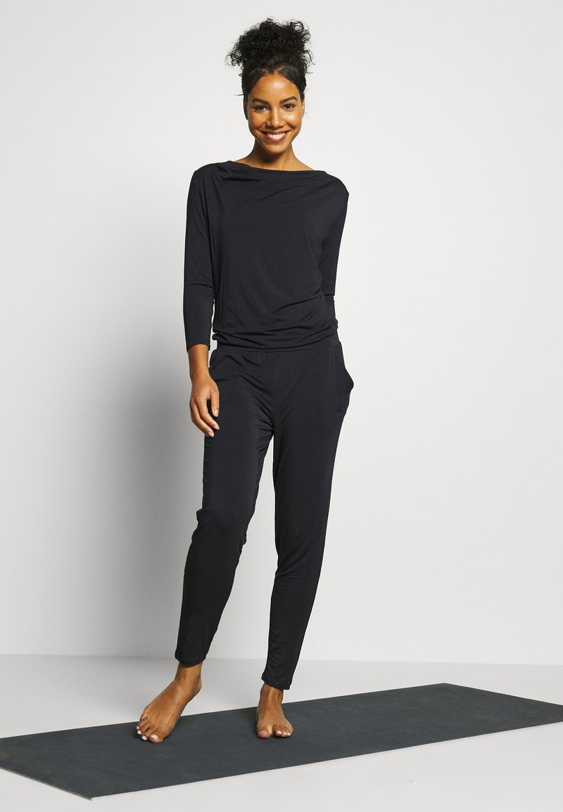 Curare Yogawear - JUMPSUIT WATERFALL - Tracksuit - midnight blue