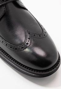 Cole Haan - ORIGINAL GRAND WINGTIP OXFORD - Business sko - black - 5