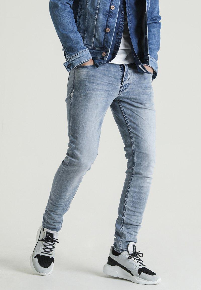 CHASIN' - EGO ROGER 2.0 - Slim fit jeans - blue