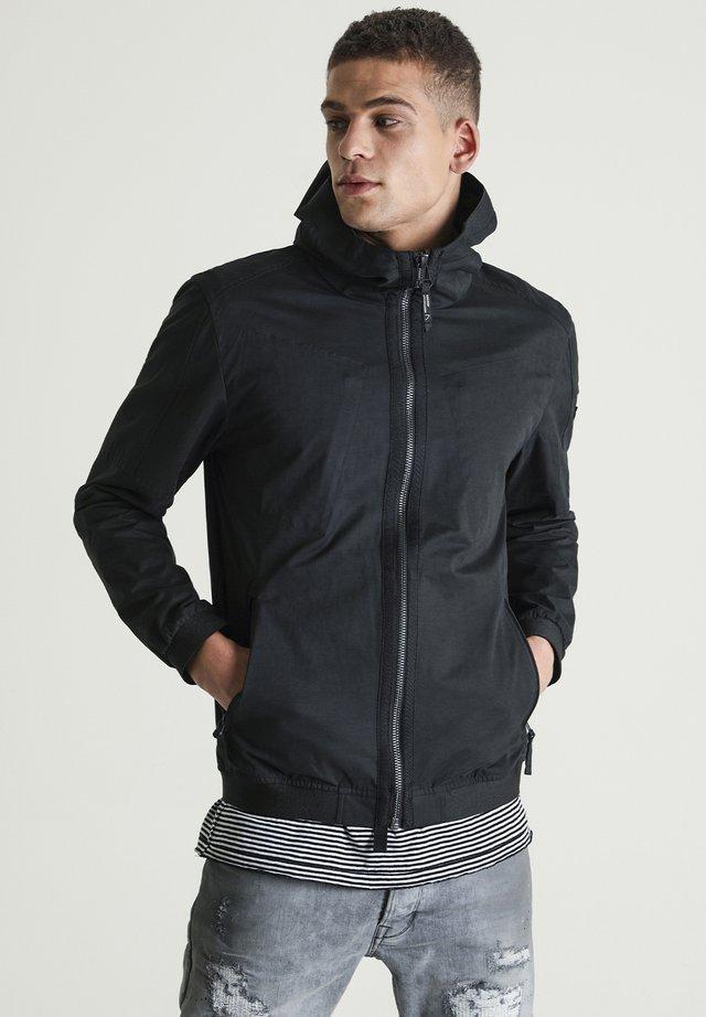 OMEGA - Light jacket - black