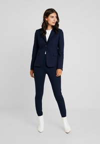 Cortefiel - BASIC WITH BUTTONS - Leggings - marine blue - 1