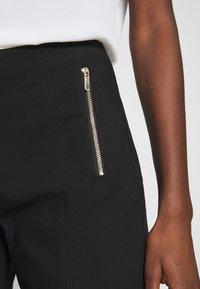 Cortefiel - BASIC SLIM TROUSERS - Pantalones chinos - black - 4