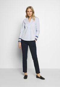 Cortefiel - POPLIN WITH CONTRAST COLLAR AND CUFFS - Blusa - light blue - 1