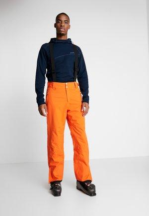 ACHIEVE PANT - Skibroek - clementine