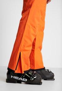Dare 2B - ACHIEVE PANT - Täckbyxor - clementine - 4