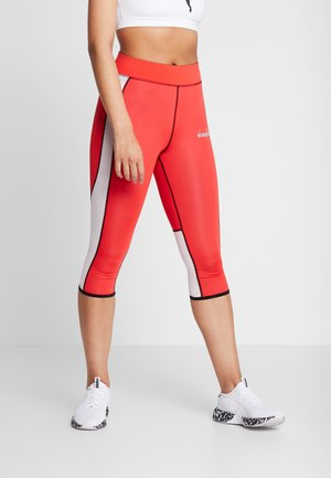 REVERSIBLE - Leggings - lively hibiscus red