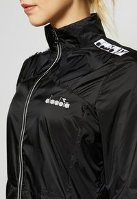 Diadora - LIGHTWEIGHT JACKET - Veste coupe-vent - black - 4