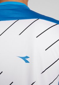 Diadora - T-shirt med print - blue deep water