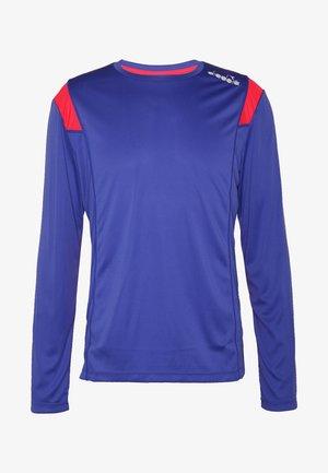 RUN - Long sleeved top - blue regista