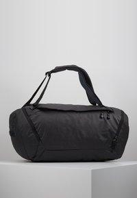 Deuter - AVIANT DUFFEL PRO 60 - Sports bag - black - 2