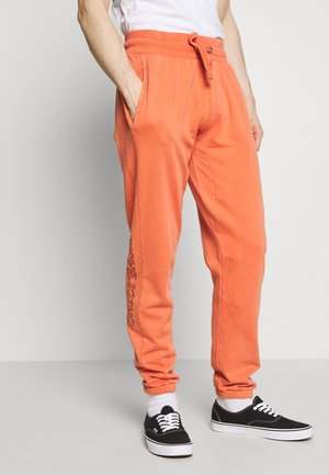 DAILY BASIS - Tracksuit bottoms - peach