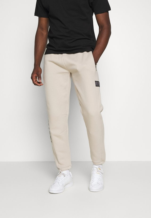 DAILY BASIS JOGGERS - Tracksuit bottoms - taupe