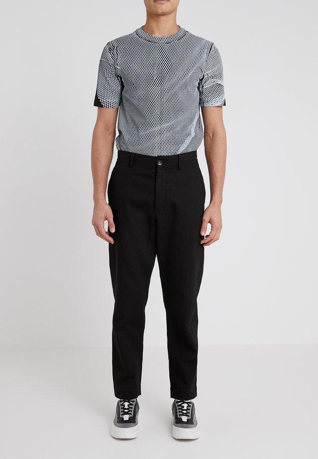 POWE - Spodnie materiałowe - black