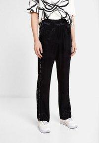 Desigual - Pantaloni sportivi - black - 0