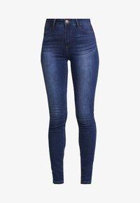 Desigual - BASIC SKIN - Slim fit jeans - denim medium wash - 4