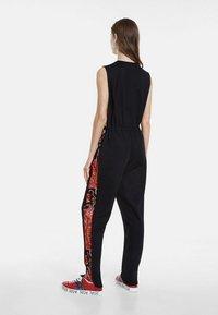 Desigual - DESIGNED BY CHRISTIAN LACROIX - Jumpsuit - black - 2