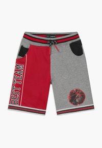 Desigual - STREET - Pantalones deportivos - rojo - 0