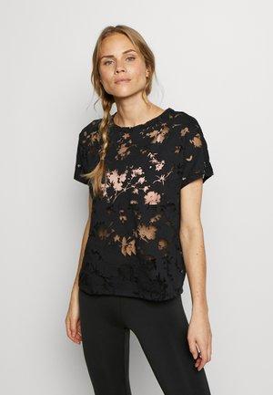 DEVORE - T-shirt med print - black