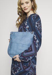 Desigual - BOLS HELA FOLDED - Handbag - azul media noche - 1