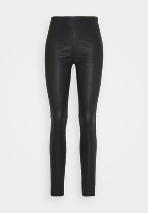 STRETCH - Trousers - black
