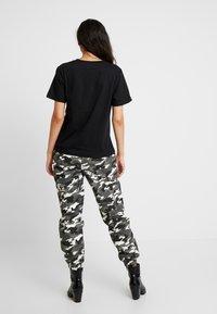 Dedicated - MYSEN FUTURE IS FEMALE - Print T-shirt - black - 2