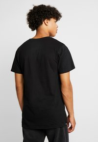 Dedicated - STOCKHOLM HUMAN BEING - Camiseta estampada - black - 2