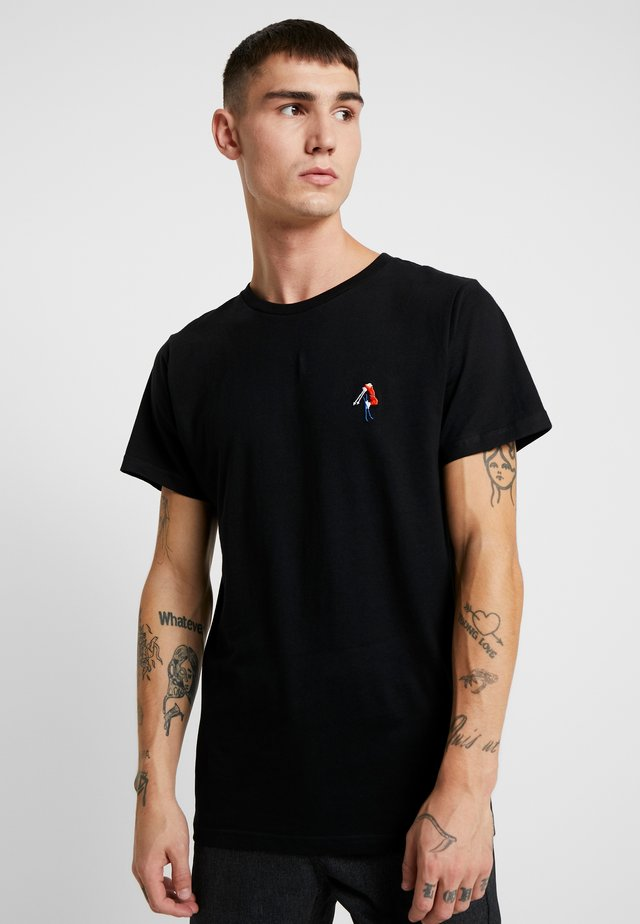 STOCKHOLM BACK SCRATCH - Print T-shirt - black