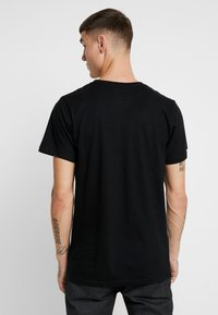 Dedicated - STOCKHOLM BACK SCRATCH - T-shirt print - black - 2