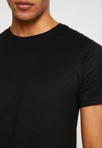 Dedicated - STOCKHOLM - T-shirt basic - black - 5