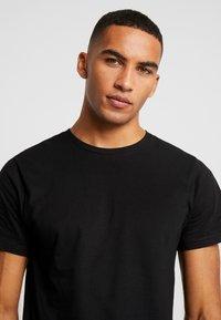 Dedicated - STOCKHOLM - T-shirt basic - black - 4