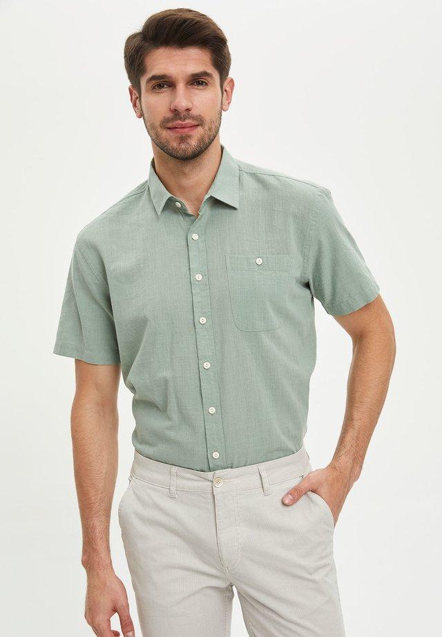 Skjorter - turquoise