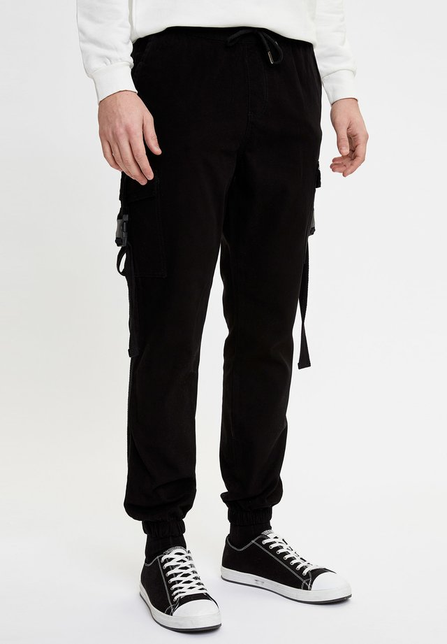 Reisitaskuhousut - black