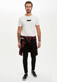 DeFacto - Slim fit jeans - black - 3