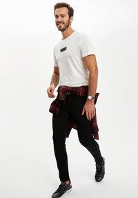 DeFacto - Slim fit jeans - black - 4