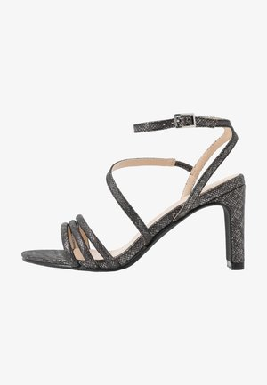 High heeled sandals - black metal