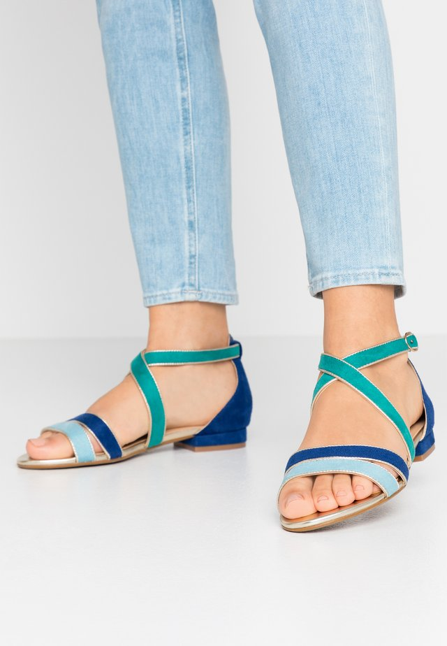 Sandaalit nilkkaremmillä - bleu/vert