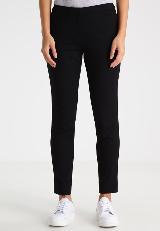 NELLY - Trousers - black