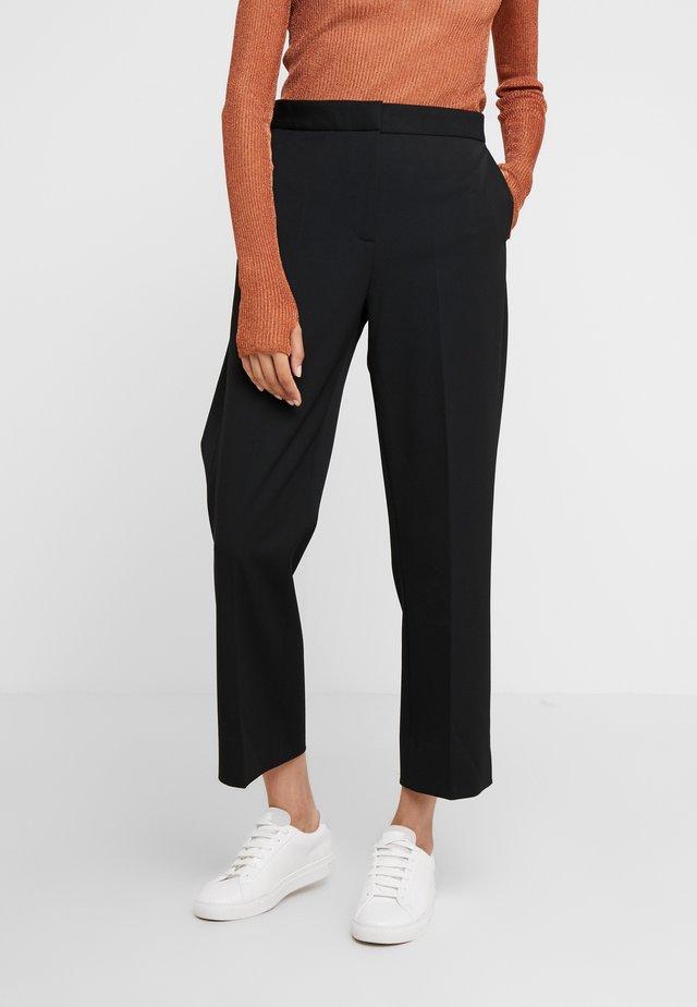 JUDITH - Trousers - black