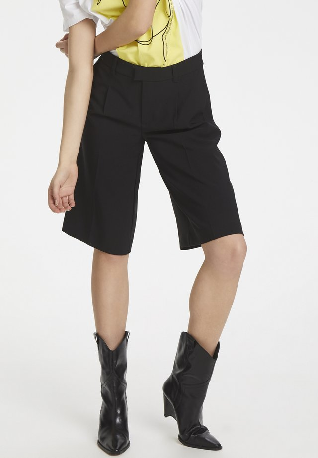 DHIDA - Shorts - black