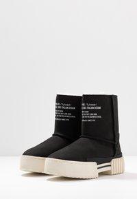 Diesel - MERLEY - Platform ankle boots - black - 4