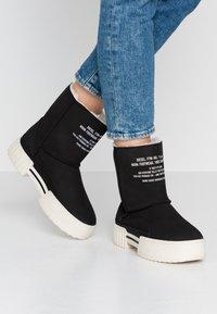Diesel - MERLEY - Platform ankle boots - black - 0