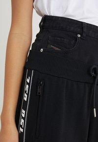 Diesel - M-SUIT-A TROUSERS - Pantalones deportivos - black - 3