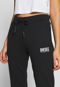 Diesel - VICTADIA TROUSERS - Spodnie treningowe - black - 4